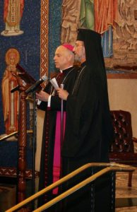 Metropolitan Gerasimos and Archbishop Cordileone praying together.